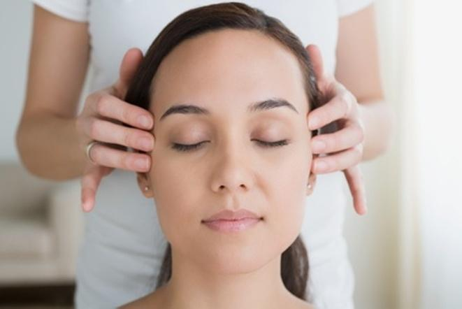 Woman having head massage